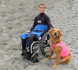 surf dog with disabled boy
