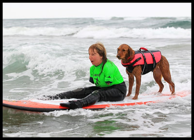 woman with no arms surfs with dog