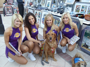 Dog and cheerleaders